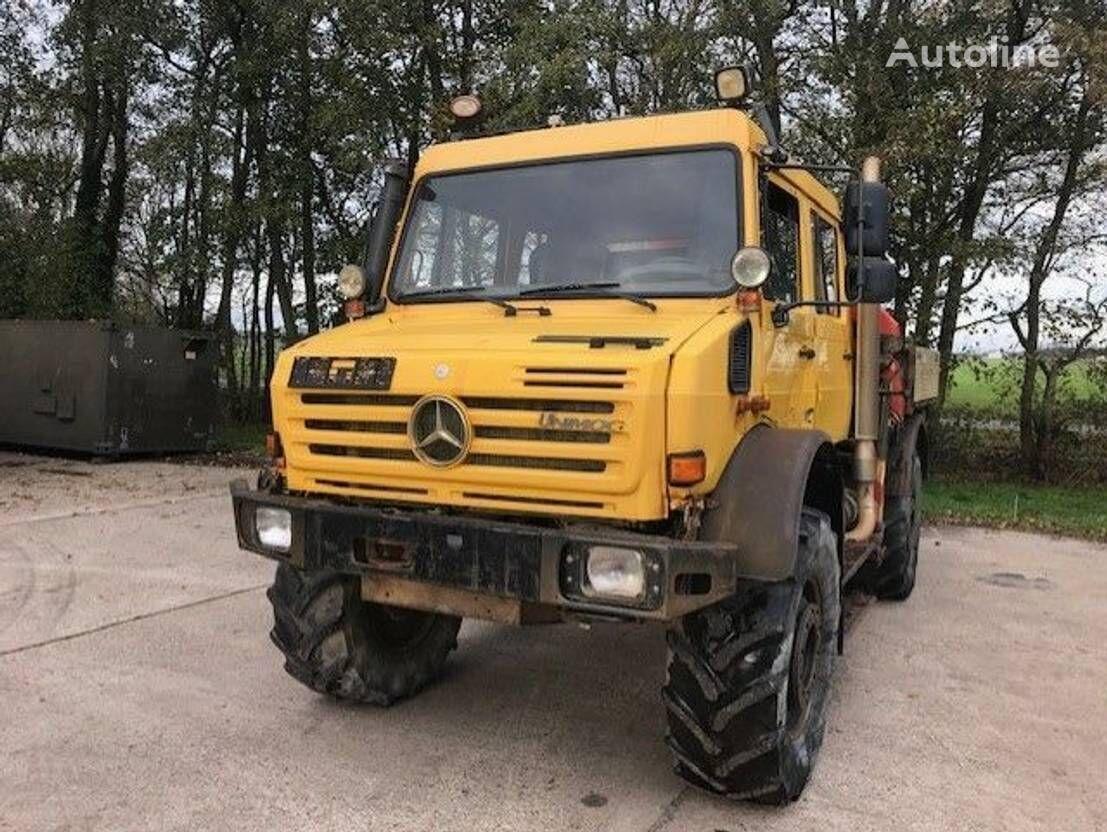 MERCEDES-BENZ Unimog U5000 camión con gancho