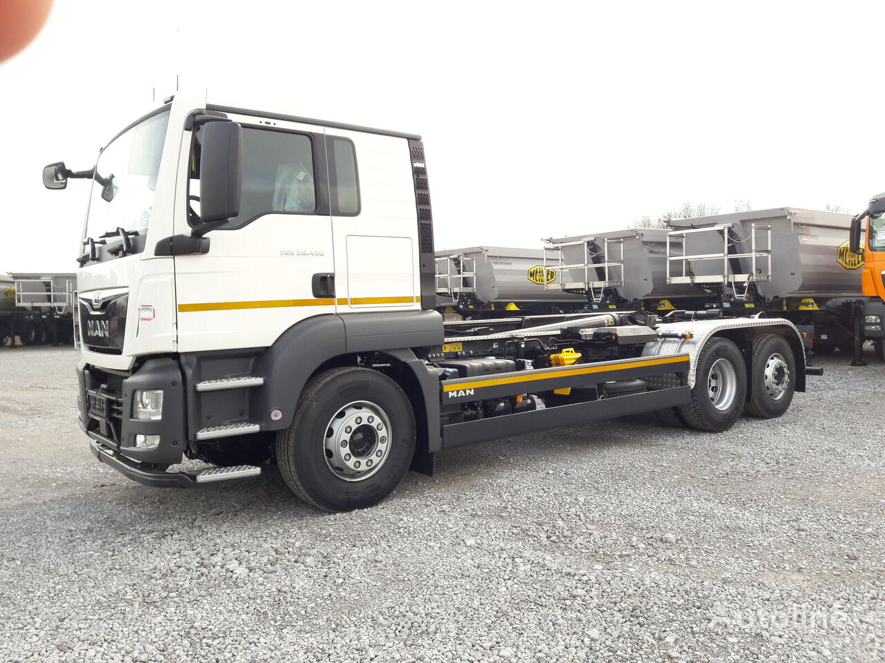 MAN TGS 26.430 camión con gancho nuevo