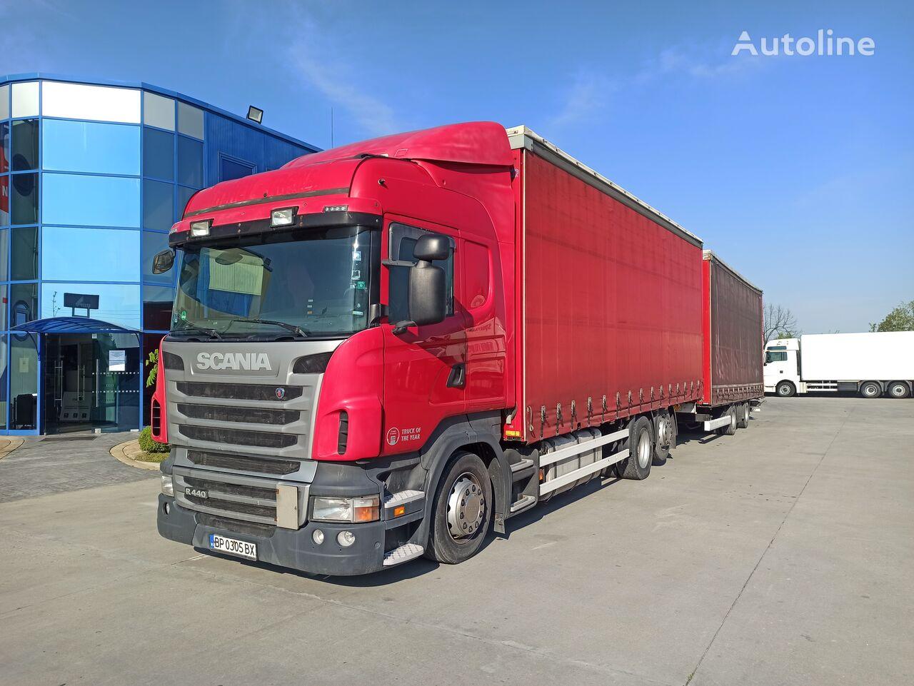 SCANIA R440 camión con lona corredera + remolque con lona corredera