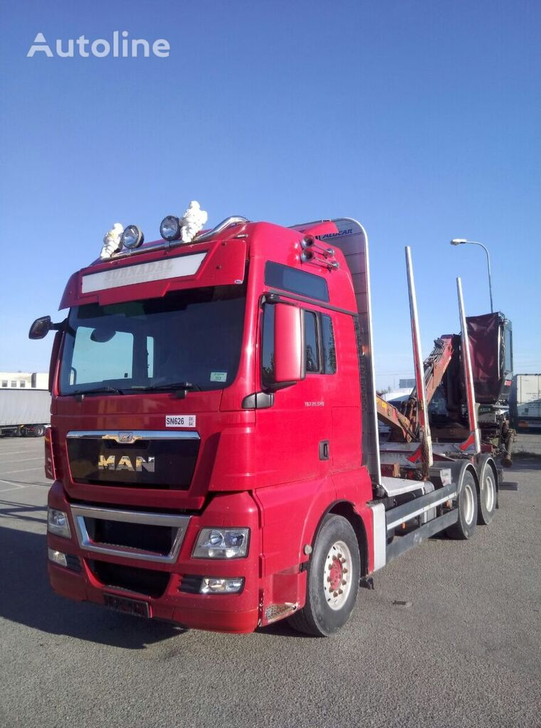 camión maderero MAN TGX 26.540