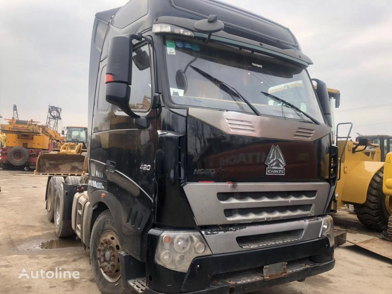 HOWO Black tractor truck cheap for sale volquete