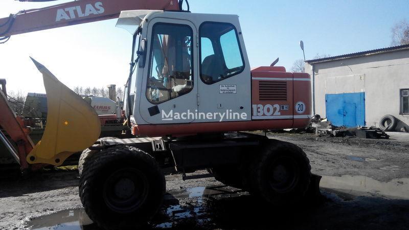 ATLAS 1302 excavadora de ruedas