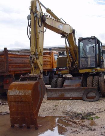 CATERPILLAR 312 excavadora de ruedas