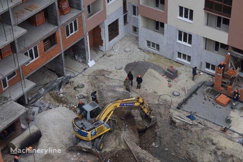 NEW HOLLAND Mono City excavadora de ruedas