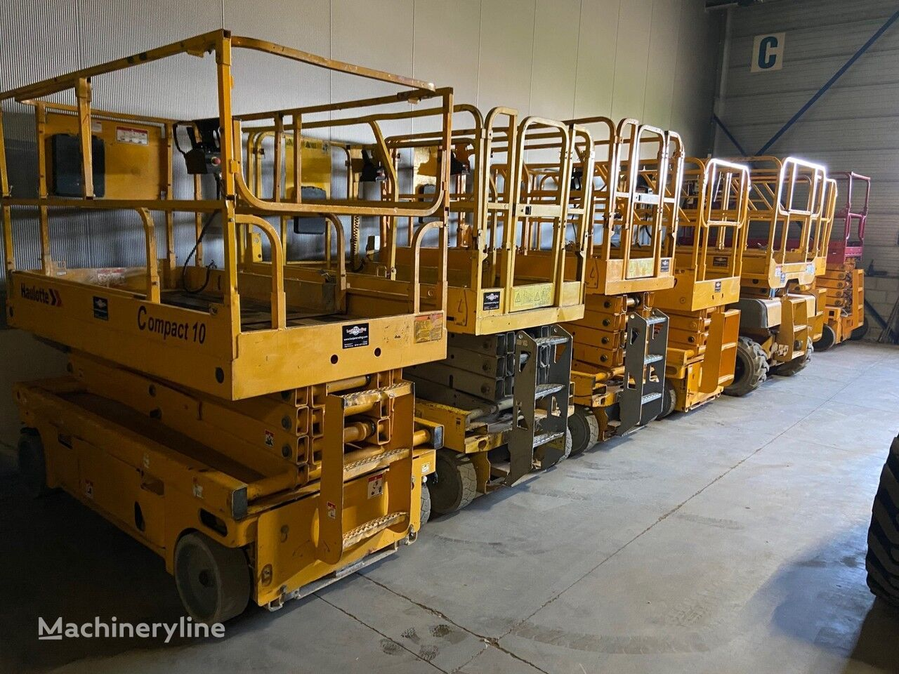 Onbekend We have over 30 electric scissorlift in stock !!! plataforma de tijera